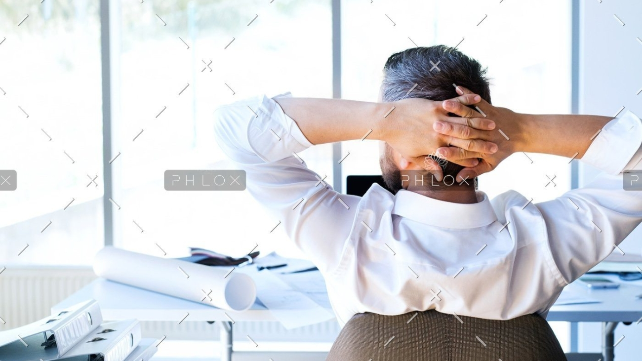 demo-attachment-135-Businessman-at-the-desk-in-his-office-resting.