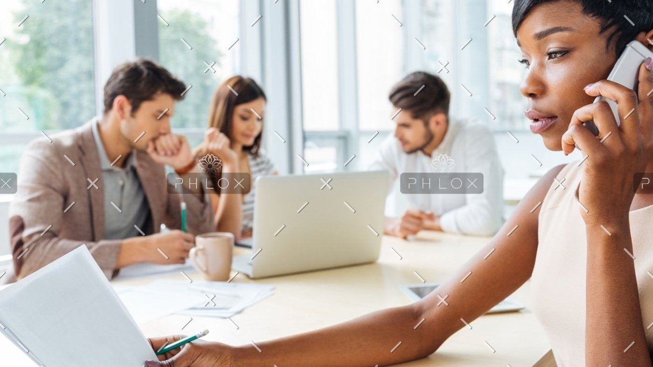demo-attachment-129-serious-businesswoman-with-documents-talking-on-P9Q6LX6